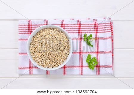 bowl of pearl barley on checkered dishtowel