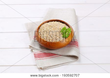 bowl of pearl barley on folded place mat