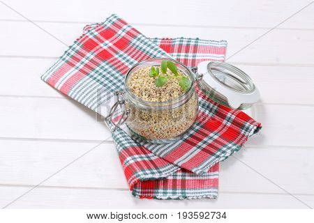 jar of pearl barley on checkered place mat