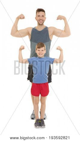 Dad and son showing muscles on white background
