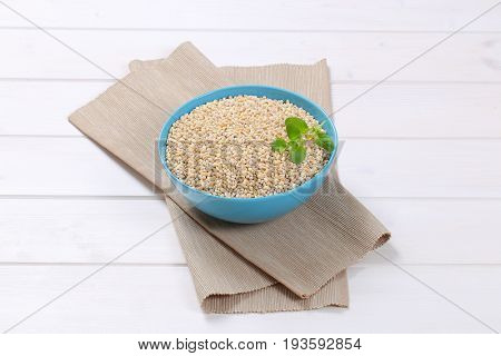 bowl of pearl barley on beige place mat