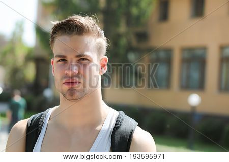 Young Male With Serious Or Concentrated Face Expression, School Background