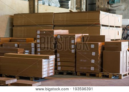 brown paper package boxes in a storage room