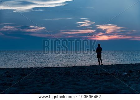 Angler In The Beach