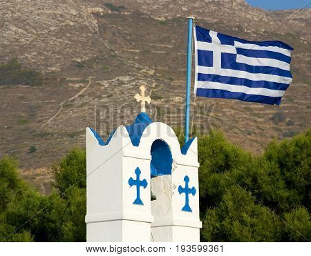 Greek flag on the belfry of Agios Nikolaos church, Parikia, Paros, Cyclades, Greece