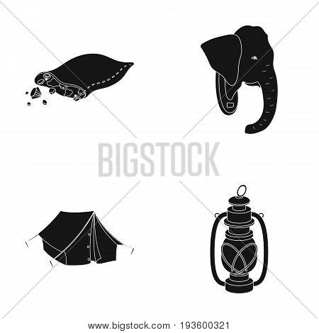 A bag of diamonds, an elephant's head, a kerosene lamp, a tent. African safari set collection icons in black style vector symbol stock illustration .
