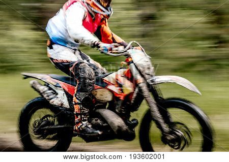 blurred motion close-up motorcycle enduro in motorcycle