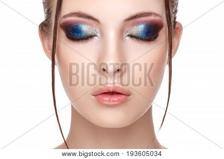 Closeup portrait of a beautiful young model with beautiful glamorous makeup the wet effect on her face and body eyes closed copy space your text here front view