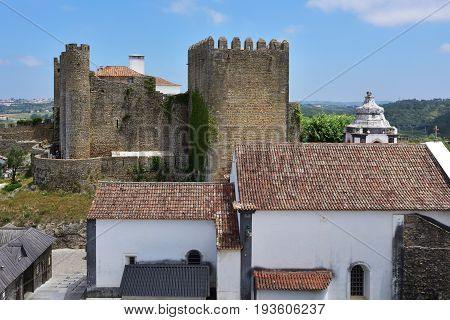 Obidos castle and village. Obidos is an ancient medieval Portuguese village from the 11th century still inside castle walls. Obidos Portugal