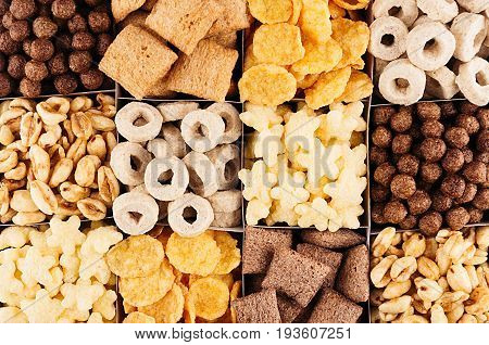 Corn flakes collection on different cereals decorative background. Top view.