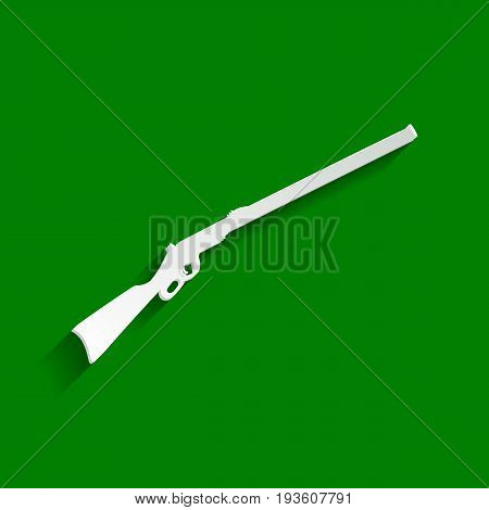 Hunting rifle icon vector illustration. Silhouette gun. Vector. Paper whitish icon with soft shadow on green background.