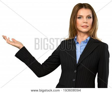 Beautiful young woman, businesswoman looking at camera pointing with hand