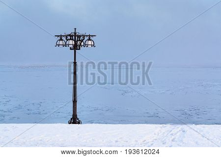 Snowy Embankment Along The Misty River With Lantern At The Foggy Morning - Winter Landscape. Ii