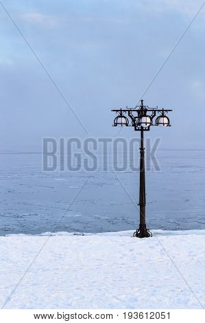 Snowy Embankment Along The Misty River With Lantern At The Foggy Morning - Winter Landscape. Iii