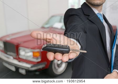 Salesman Is Selling A New Car And Passing Keys.