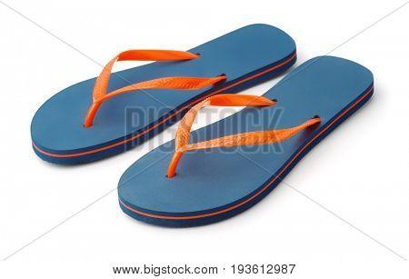 Pair of blue flip flops isolated on white