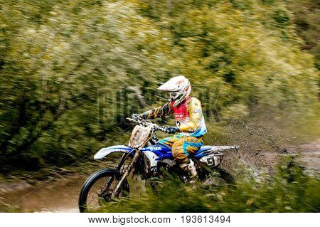 Kyshtym Russia - June 18 2017: athlete bike enduro riding puddle of water and mud during Ural Cup in Enduro