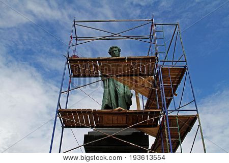 Moscow Russia - June 30 2015: Monument of famous russian poet Alexander Pushkin is closed for reconstruction on Pushkin square in Moscow
