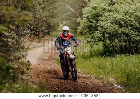 Kyshtym Russia - June 18 2017: enduro athlete on bike rides in forest trial during Ural Cup in Enduro