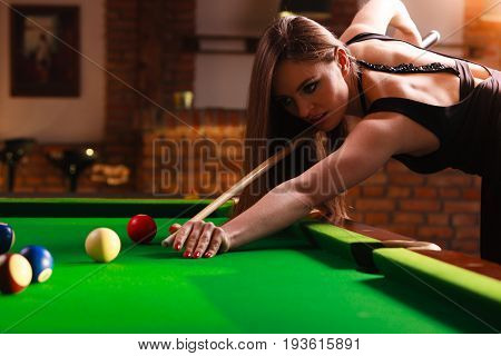 Young Woman Playing Billiard.