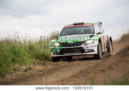 Mikolajki, Poland - 1 July 2017: Ole Christian Veiby and his codriver Stig Rune Skjaermoen  in a Skoda Fabia R5 race in the 74nd Rally Poland, on July 1, 2017 in Mikolajki, Poland.