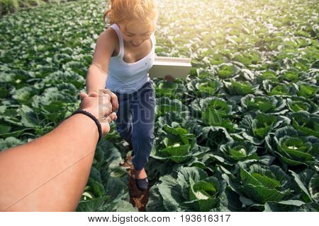 Lover men and women asia shake hands in the garden. Morning atmosphere The mountains are foggy. phetchabun phutubberg thailand