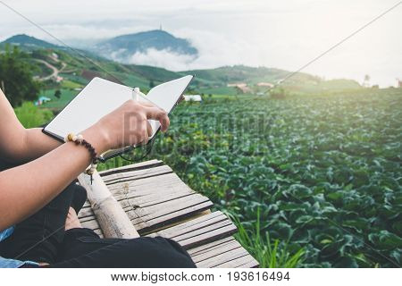 Read women relax in the park. Morning atmosphere The mountains are foggy. phetchabun phutubberg thailand