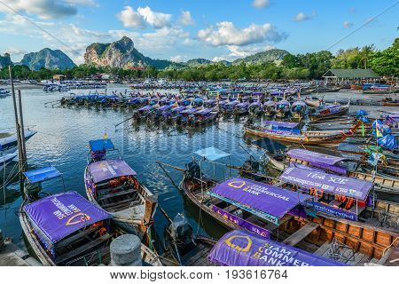 KRABI THAILAND - MAY 4 2015: Tourist boats floating on sea of bay to provide transportation service to tourists to any other islands nearby Krabi Thailand