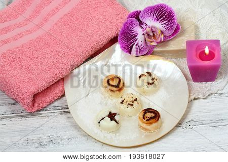 Spa set massage with sugar scrub bars on the shell. Spa treatment on the white wooden table