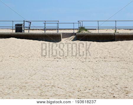beach sky and railings at crosby in merseyside