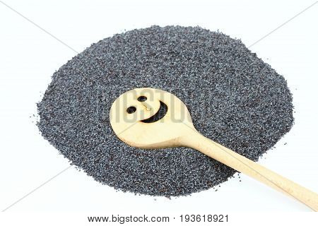 Organic dry poppy seeds on white background. Poppy seeds with funny stirring wooden spoon