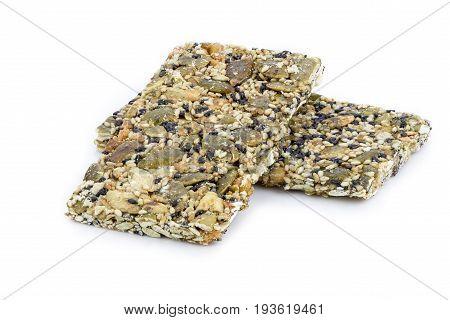 Granola Bar (sesame, Sunflower Seed And Pumpkin Seed Bar) On White Background