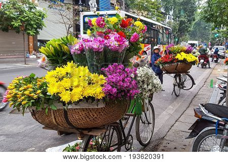 Hanoi Vietnam - 21 Feb 2017 : Florists are selling flowers on the street at the old district in Hanoi Vietnam.