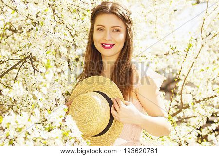 Flowers Are Everywhere. Portrait Of Smiling Beautiful And Young Long-haired Girl Standing On Flower