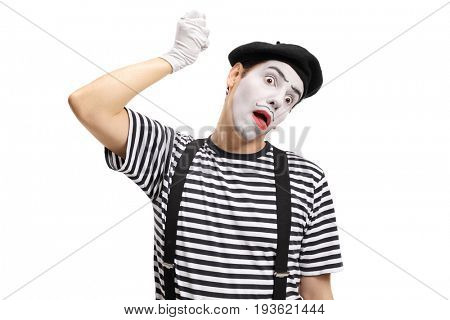 Mime artist hanging himself with an imaginary rope isolated on white background