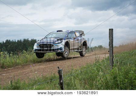 Mikolajki, Poland - 1 July 2017: Ott Tanak and his codriver Martin Jarveoja M-Sport World Rally Team in a Ford Fiesta WRC race in the 74nd Rally Poland, on July 1, 2017 in Mikolajki, Poland.