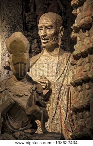 Xian China May 29 2017 Stone Buddha and relics from the Zhongshan Grottoes in Zichang County displayed at the Shaanxi History Museum in Xian Shaanxi Province in China