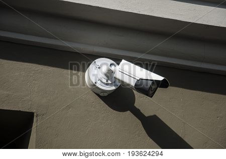 surveillance camera on side of the building