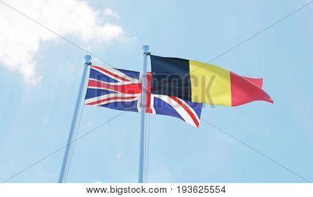 Great Britain and Belgium, two flags waving against blue sky. 3d image