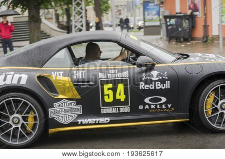 Riga, Latvia - July 01, 2017: Porsche Turbo S Cabriolet from Gumball 3000 race Riga to Mykonos with driver. Riga host Gumball 3000 during the 2017 Rally being the starting grid destination.
