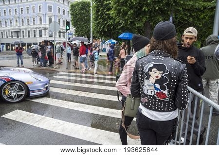Riga, Latvia - July 01, 2017: Riga host Gumball 3000 during the 2017 Rally being both the starting grid and flag drop destination. Visitors and staff of Gumball 3000 race Riga to Mykonos.