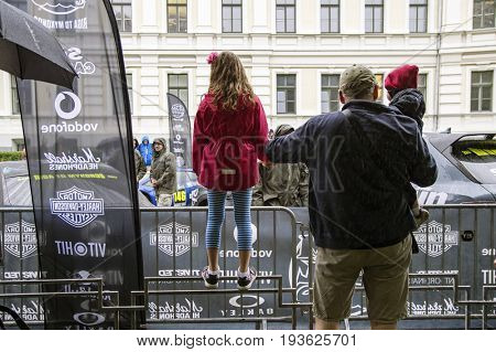Riga, Latvia - July 01, 2017: Riga host Gumball 3000 Race during the 2017 Rally being both the starting grid and flag drop destination.Visitors of event watching parade of super cars.