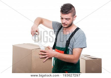 Mover Guy Using Duct Tape On Cardboard Box