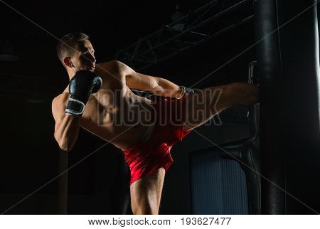 The Fighter Of Mixed Martial Arts Beats The Bag With His Left Foot