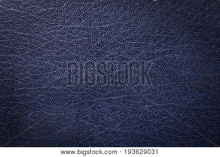 Dark blue synthetic leather texture with soft central light