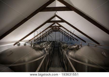 Stainless steel vats in brewery