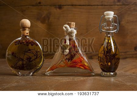 Bottles Extra Virgin Olive Oil With Spices On A Ceramic Background