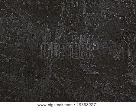 Dark gray black venetian plaster background texture. Traditional venetian plaster texture grain pattern drawing. Classic stucco plaster stone texture. Gray traditional Venetian plaster wall texture