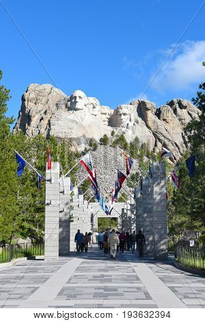 KEYSTONE, SOUTH DAKOTA - JUNE 23, 2017: Mount Rushmore National Memorial. Avenue of Flags with the monuments in the distance.