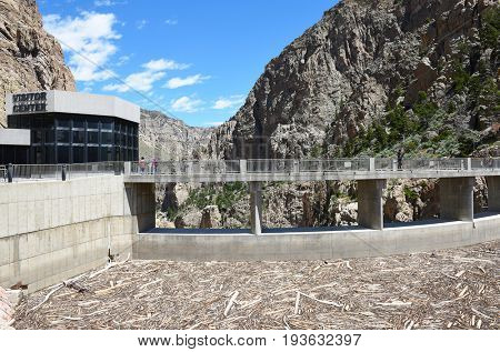 CODY, WYOMING - JUNE 24, 2017: Buffalo Bill Dam debris buildup. The dam on the Shoshone River is named after the famous wild west figure William Buffalo Bill Cody.
